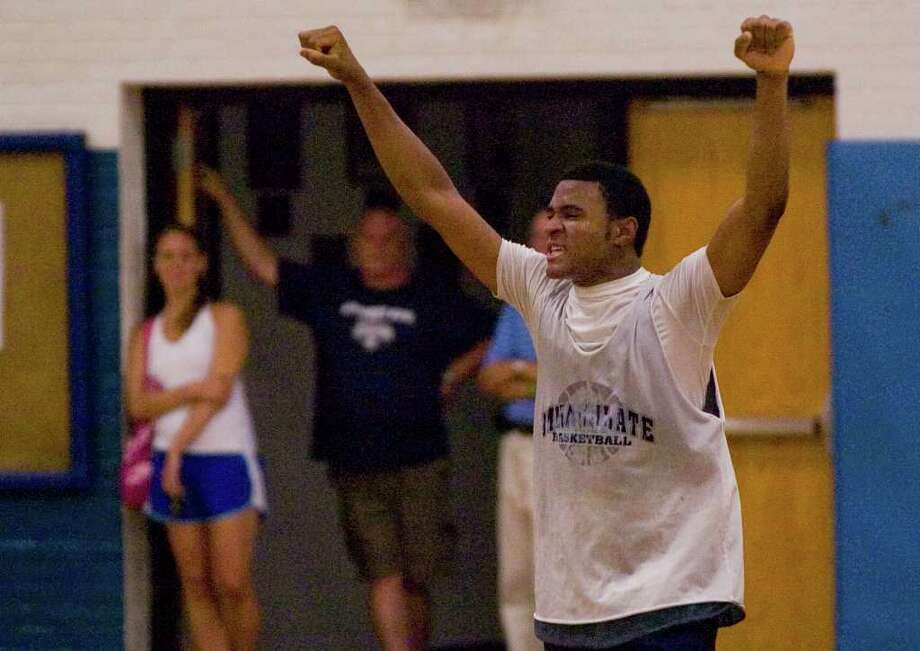 Immaculate's Sheldon Irving celebrates after their win over Danbury during the War Memorial High School Summer Basketball League Championship in Danbury on Thursday, July 28, 2011.  Immaculate won 58-56 in overtime. Photo: Jason Rearick