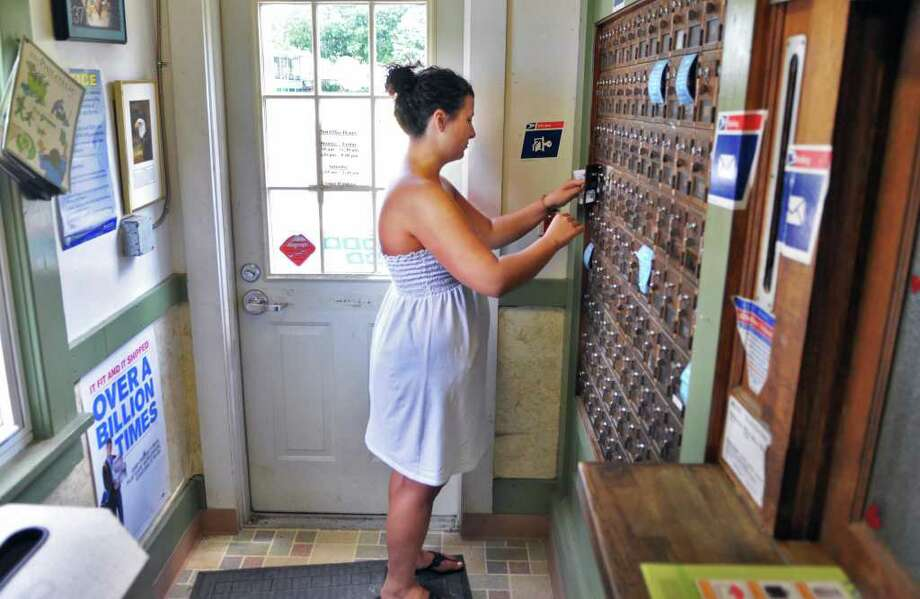 Kirsten Bowman of North Hoosick picks up her mail at the North Hoosick Post Office Wednesday July 27, 2011.  (John Carl D'Annibale / Times Union) Photo: John Carl D'Annibale