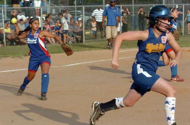 Highlights from little league softball championship action between Black Rock and Waterford in West Haven, Conn. on Thursday July 28, 2011. Waterford's Jill Jamon tosses the ball to first. Photo: Christian Abraham / Connecticut Post