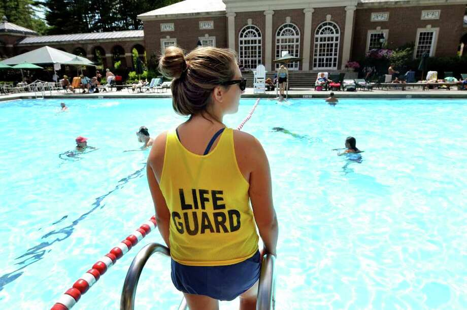 Life guard Marie Mongeon, 18, who will attend the University of Rochester in August, watches over swimmers at Victoria Pool on Wednesday, July 27, 2011, at Saratoga Spa State Park in Saratoga Springs, N.Y. (Cindy Schultz / Times Union) Photo: Cindy Schultz