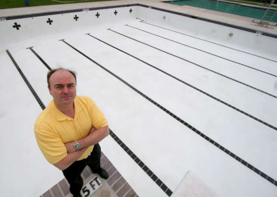 Maplewood South/North Community Improvement Association president Ralph Rieger shows off the result of recent renovations to the swimming pool at Ron Meek Park. Rieger has been president for one year and has been a resident of Maplewood since the early 1990s. The pool is a center for activity, especially during the summer. Photo: Jason Brown, For The Chronicle
