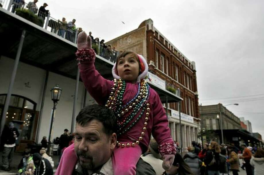 Beads will still be a regular sight at Galveston's annual celebration, but gone are live bands, and food and beverage vendors. Photo: BEN DESOTO, CHRONICLE FILE