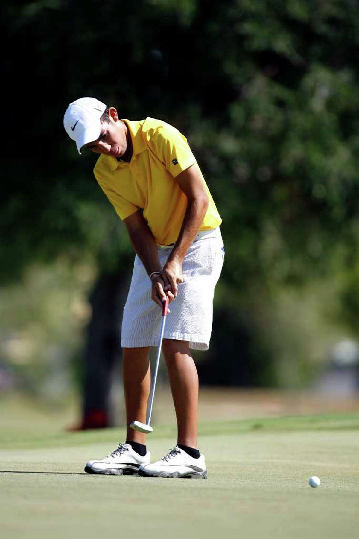Alex Bissaro putts during the Greater San Antonio Junior Championship at Brackenridge Golf Course on Thursday, July 28, 2011. Bissaro gained the title after losing on the final hole last year.