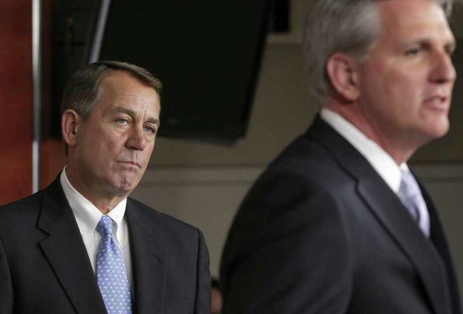 House Speaker John Boehner of Ohio listens at left as House Majority Whip Kevin McCarthy of Calif. answers a question about the upcoming vote on Boehner's bill, Thursday, July 28, 2011, during a news conference on the debt crisis showdown, on Capitol Hill in Washington.  (AP Photo/J. Scott Applewhite) Photo: J. Scott Applewhite