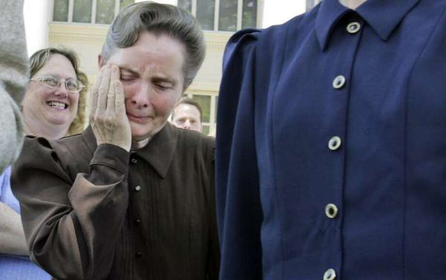 Fundamentalist Church of Jesus Christ of Latter Day Saints member Marie Steed cries last week in San Angelo after hearing that a court ruled the state had no right to seize most of the sect's children. Photo: LM OTERO, ASSOCIATED PRESS
