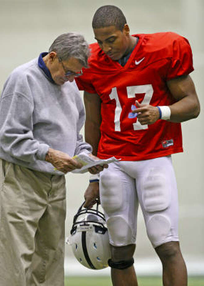 Joe Paterno (with quarterback Daryll Clark) is expected to lead Penn State to a fourth-place finish in the Big Ten, according to a media poll. Photo: Carolyn Kaster, AP