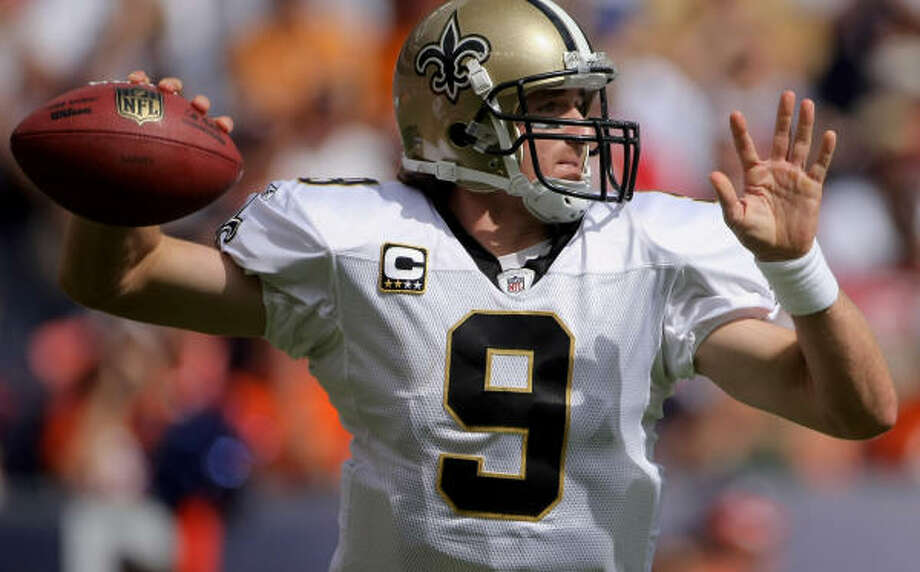 Drew Brees became only the second player in NFL history to throw for more than 5,000 yards. Photo: Doug Pensinger, Getty Images
