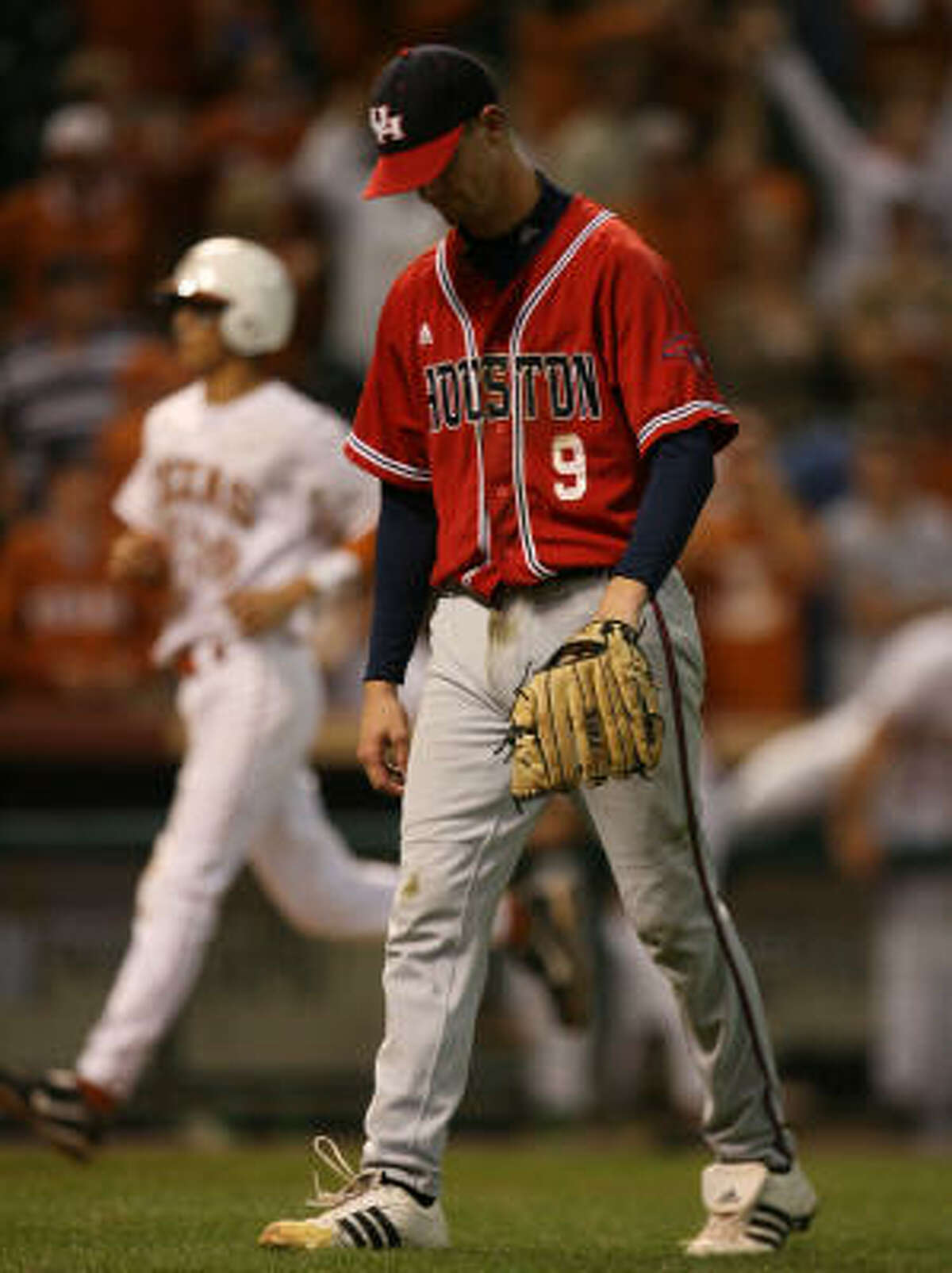UH pitcher Chase Dempsay walks off the field after giving up a a game-winning single, allowing Texas' David Hernandez to score in the bottom of the 10th inning.