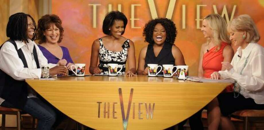 Michelle Obama, third from left, wore a casual black-and-white sundress for her Wednesday appearance on The View. She is shown with the ABC show's co-hosts. Photo: STEVE FENN, ABC   ASSOCIATED PRESS