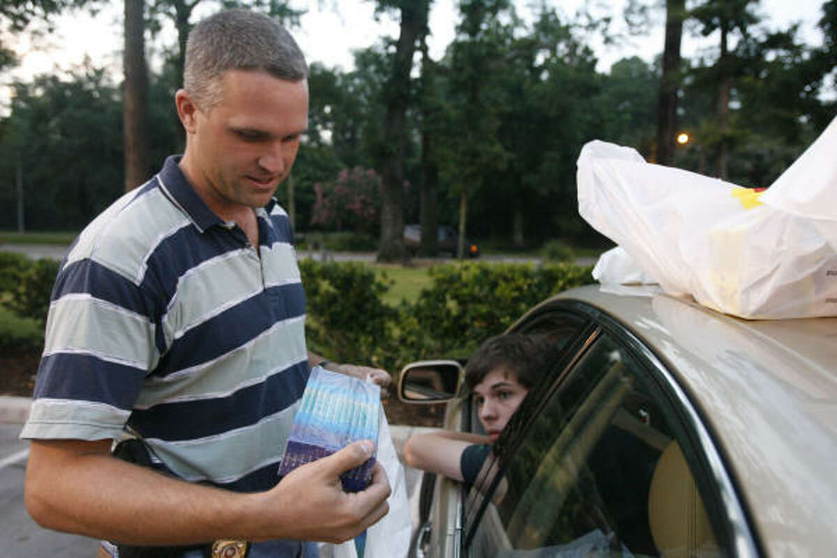 Houston Fire Department Arson Investigator Scott Clements confiscates fireworks from Pat Markovich, 18, near Kingwood.
