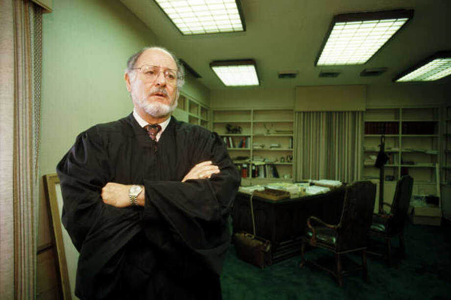 Judge James deAnda, shown in 1985 in Houston's federal building, was not well known, despite his important work. Photo: Howard Castleberry, Chronicle