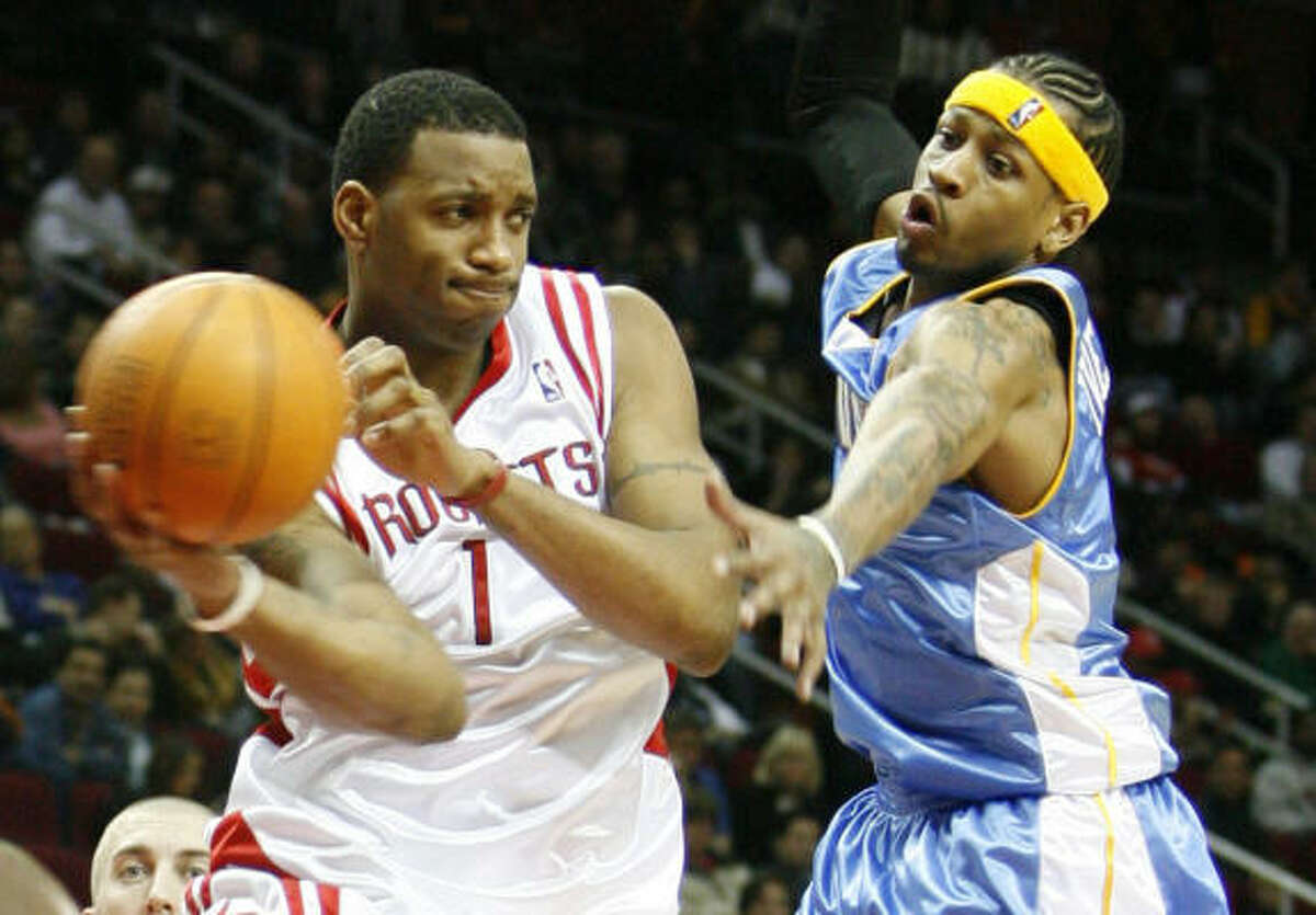 Tracy McGrady edged new Nuggets guard Allen Iverson for a spot in the Western Conference starting lineup.