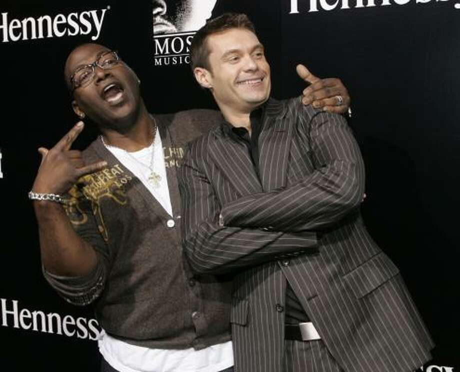 American Idol judge Randy Jackson, left, and host Ryan Seacrest are helping usher new terminology into our pop-culture-inspired vocabularies. Photo: DANNY MOLOSHOK, ASSOCIATED PRESS