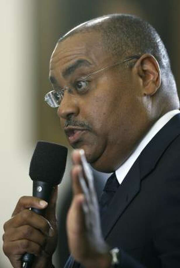 """Sen. Rodney Ellis, D-Houston, speaks Tuesday about his bill to give journalists limited privilege against being forced to testify in court or disclose confidential sources. The Senate approved the """"Free Flow of Information Act."""" Photo: Harry Cabluck, AP"""