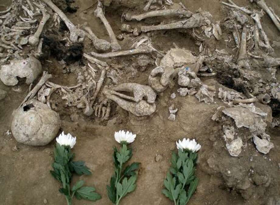 Flowers lie before human bones unearthed southeast of Seoul, where a government commission excavated remains of about 500 civilians believed killed by South Korean troops in 1951. Photo: ASSOCIATED PRESS
