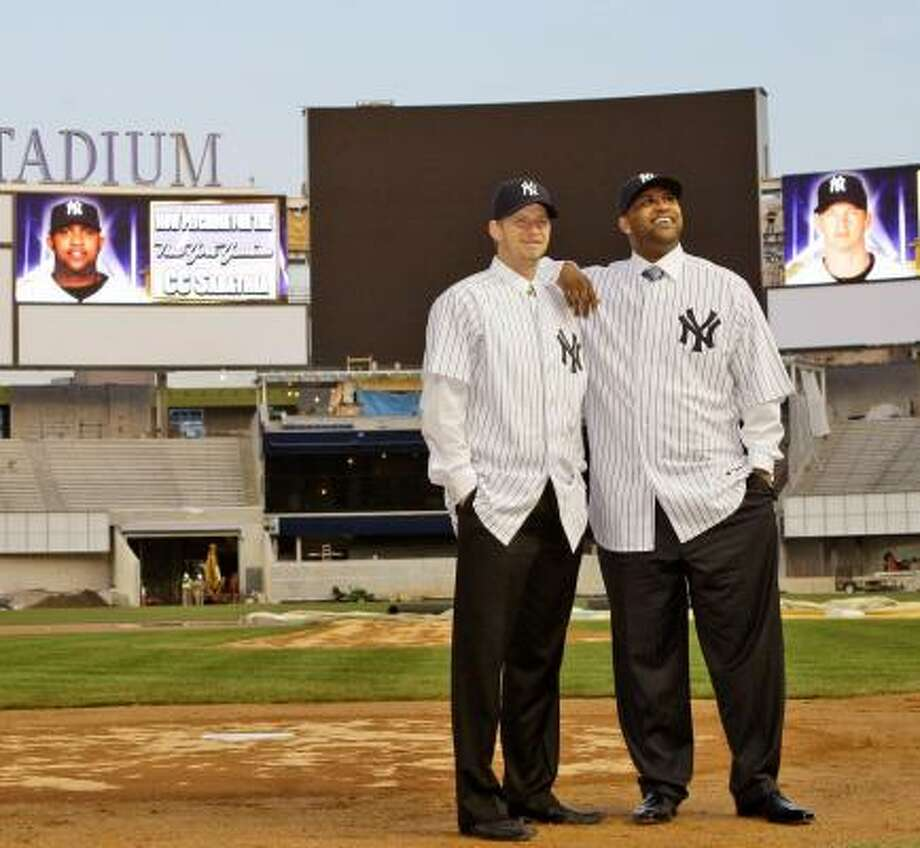 The Yankees' newest pitchers, A.J. Burnett (left) and C.C. Sabathia, pose in the new Yankee Stadium. Photo: Kathy Willens, AP
