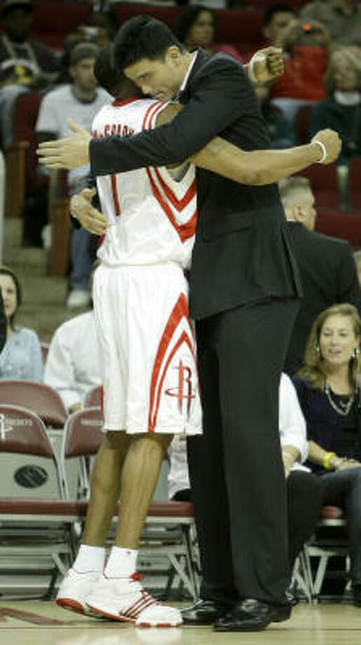 Yao Ming and Tracy McGrady hug after a game last year. Yao said Thursday that things are fine between the teammates. Photo: Brett Coomer, Chronicle