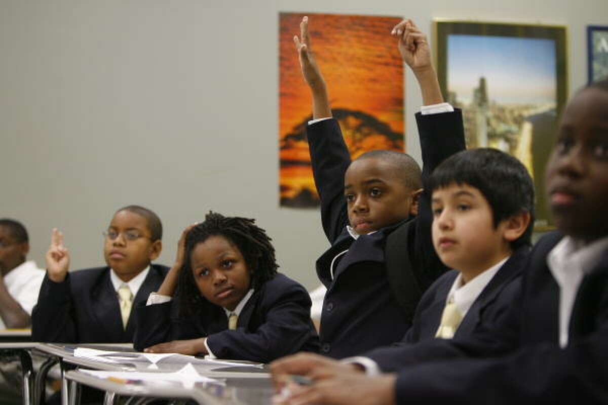 Fifth-grade students, from left, Quincy Mixom, 10, Cai Johnson, 10, Martin Fortner, 10, Angel Martinez, 11, and, Ajibola Bodunrin, 11, pay attention during a social justice class at KIPP Polaris Academy, a boys-only charter school in the North Forest area.
