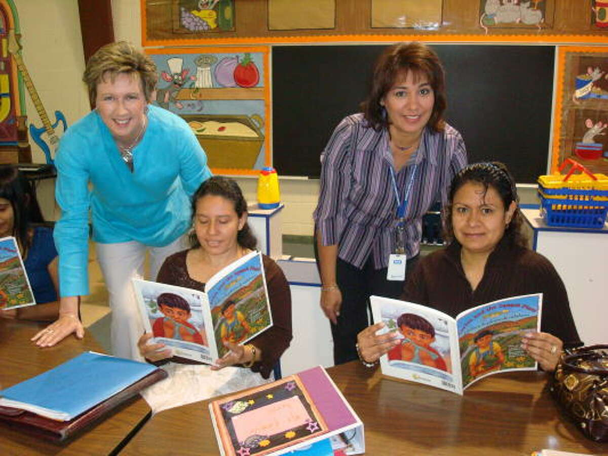 At Mission Bend Elementary School are, standing, from left: Carol Hale, principal; and Terry Hernandez, Parent Resource Center coordinator. Seated are parents Lidia Zelaya and Araceli Aguirre.