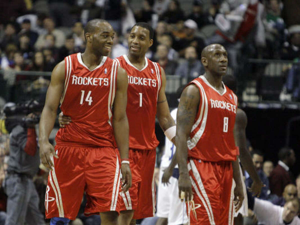 Houston Rockets forward Carl Landry (14), guard Tracy McGrady (1) and guard Bobby Jackson (8) walk off the court during a time out in the second half of a March 6 basketball game. Landry may opt to play overseas.