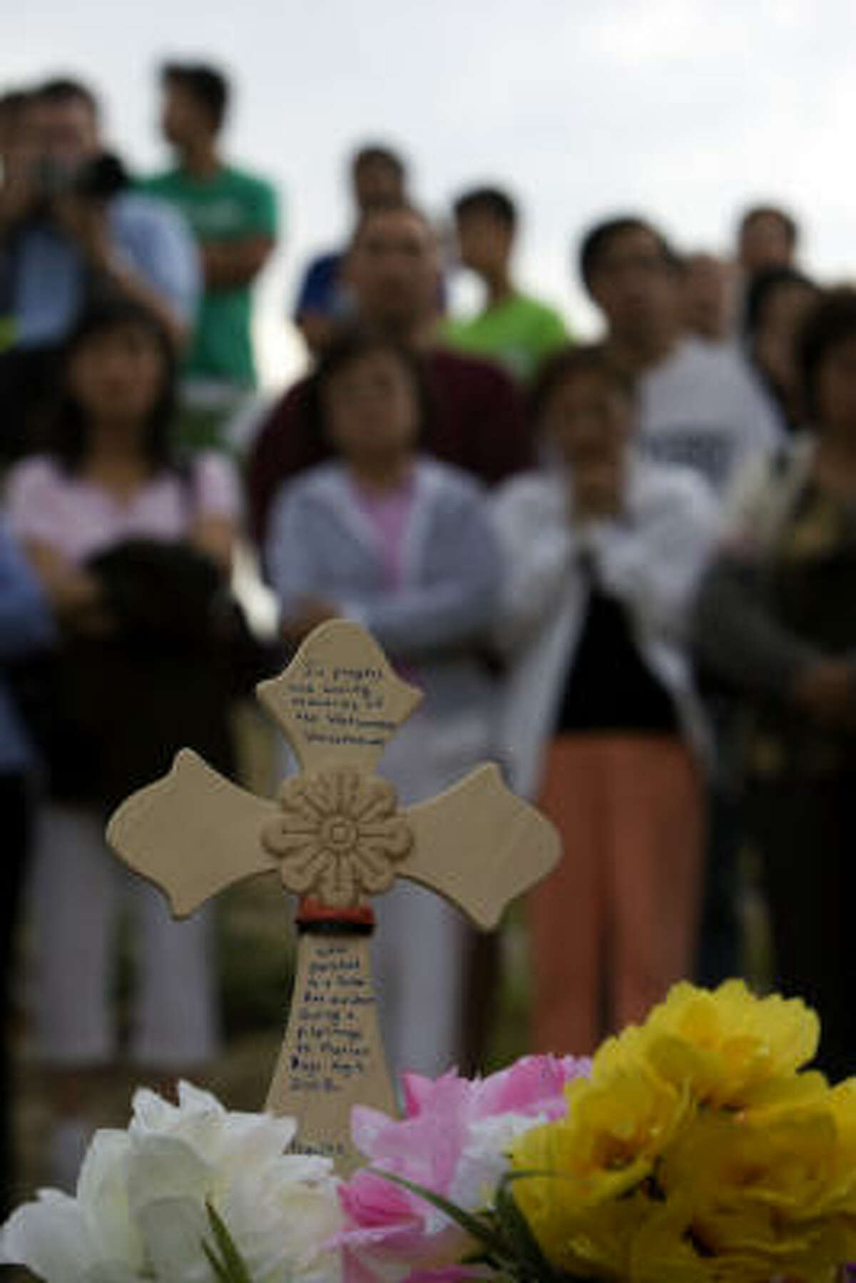 Pilgrims coming from the Marian Days religious festival in Missouri stopped alongside the road in Sherman on Sunday to pay respects to those killed in the bus crash.