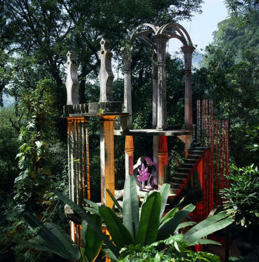 The Surrealist garden of colonnades, terraces and free-form sculptures don't so much transform the lush, natural site as exaggerate it. Photo: Rob Ziebell, Texas Gallery