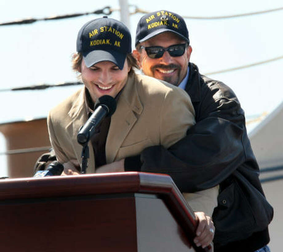 Kevin Costner, right, hugs Ashton Kutcher during a Aug. 28 appearance at the Coast Guard Station in Alameda, Calif. Photo: DINO VOURNAS, Associated Press