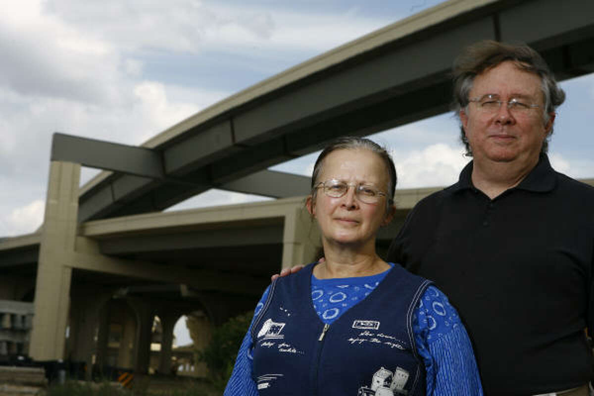 Carol Caul, left, and her husband, Bill Ware, who live about 750 feet from the Loop near its Katy Freeway interchange, have sued TxDOT, contending the agency should have performed an environmental impact study and taken steps to mitigate noise produced by the new exit.