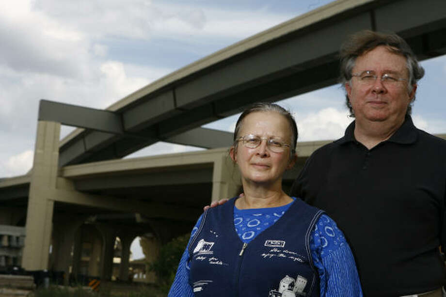 Carol Caul, left, and her husband, Bill Ware, who live about 750 feet from the Loop near its Katy Freeway interchange, have sued TxDOT, contending the agency should have performed an environmental impact study and taken steps to mitigate noise produced by the new exit. Photo: Nick De La Torre, CHRONICLE