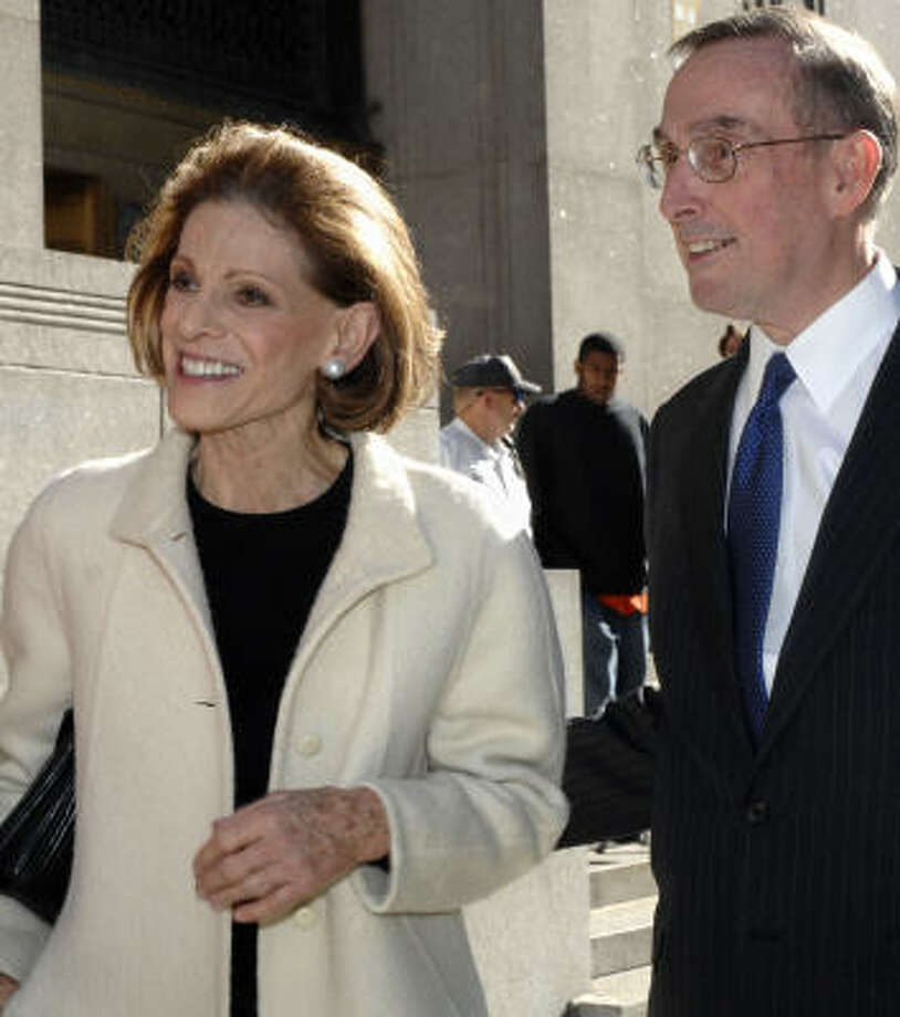Annette de la Renta exits Manhattan State Supreme Court with her attorney, Paul Saunders, on Friday in New York. Philanthropist Brooke Astor's son has been permanently removed as guardian of her multimillion-dollar estate, according to a settlement announced in court Friday. Photo: LOUIS LANZANO, AP