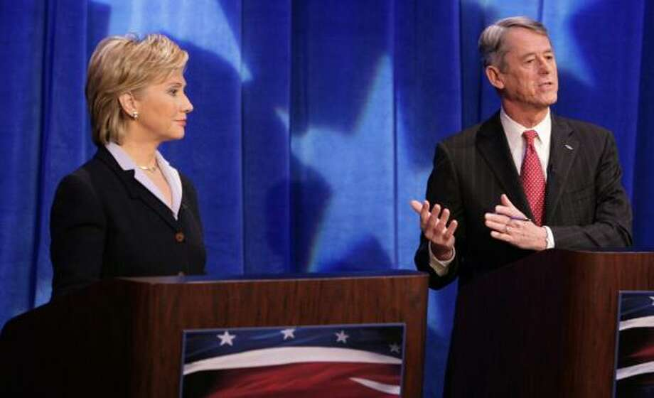 In Sunday's televised debate, Sen Hillary Rodham Clinton listens as Senate challenger John Spencer explains how she would be a good presidential candidate, from a Republican standpoint. Photo: POOL, REUTERS