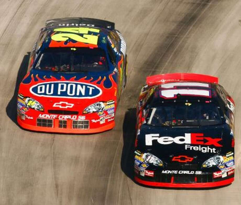 Denny Hamlin (in the car at right) still has a shot at the Nextel Cup. Photo: Chris Graythen, Getty Images For NASCAR