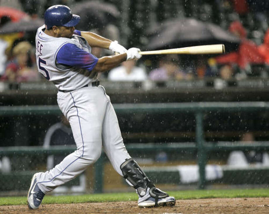 Hard-hitting Rangers left fielder Carlos Lee would be an automatic upgrade in the Astros' outfield. Photo: PAUL SANCYA, AP