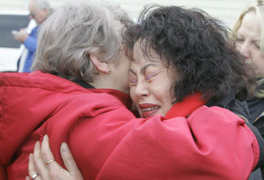Lou Ann Cameron, left, mother of Kelly James, and Maria Kim, mother of Jerry Cooke, comfort each other Saturday. Their sons and another climber have been missing on Mount Hood since Dec. 7. Photo: Rick Bowmer, AP