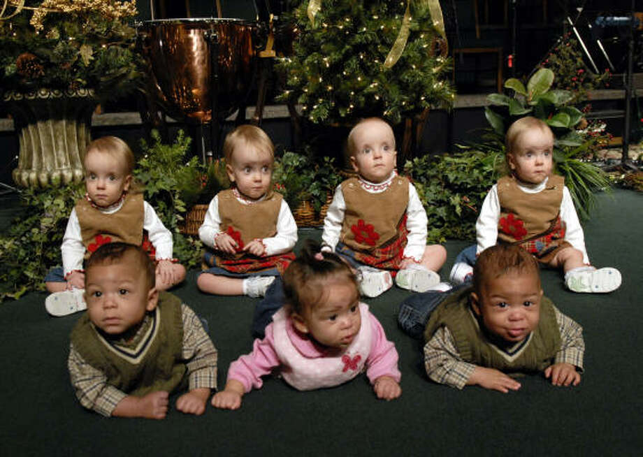 The Breedlove daughters, back row from left, Adelle, Bonnie, Chloe and Daphne, age 20 months, get together with the Mills infants, from left, Devin, Morgan and Kyle. The Mills family lost Jayden, the fourth quad, in August. Photo: Kim Christensen, For The Chronicle