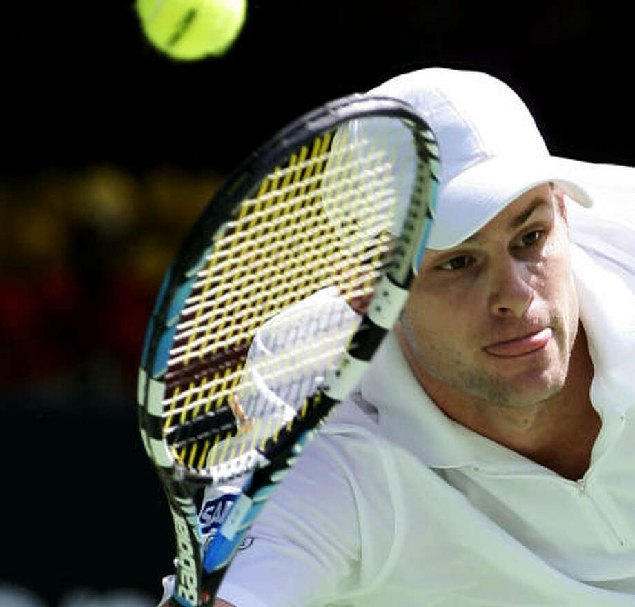 Sixth-seeded Andy Roddick defeated Mardy Fish, his former housemate, 6-2, 6-2, 6-2. Photo: ROB GRIFFITH, AP