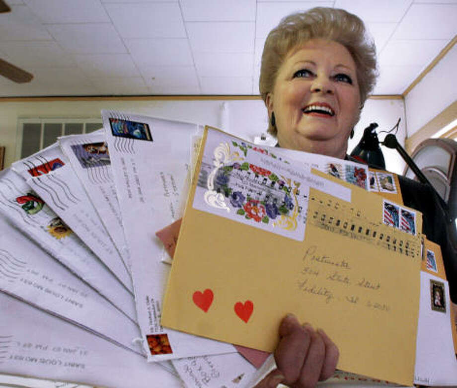 Peggy Ruyle of Fidelity, Ill., helps keep romance alive on Valentine's Day, one postmark at a time. Photo: Seth Perlman, AP
