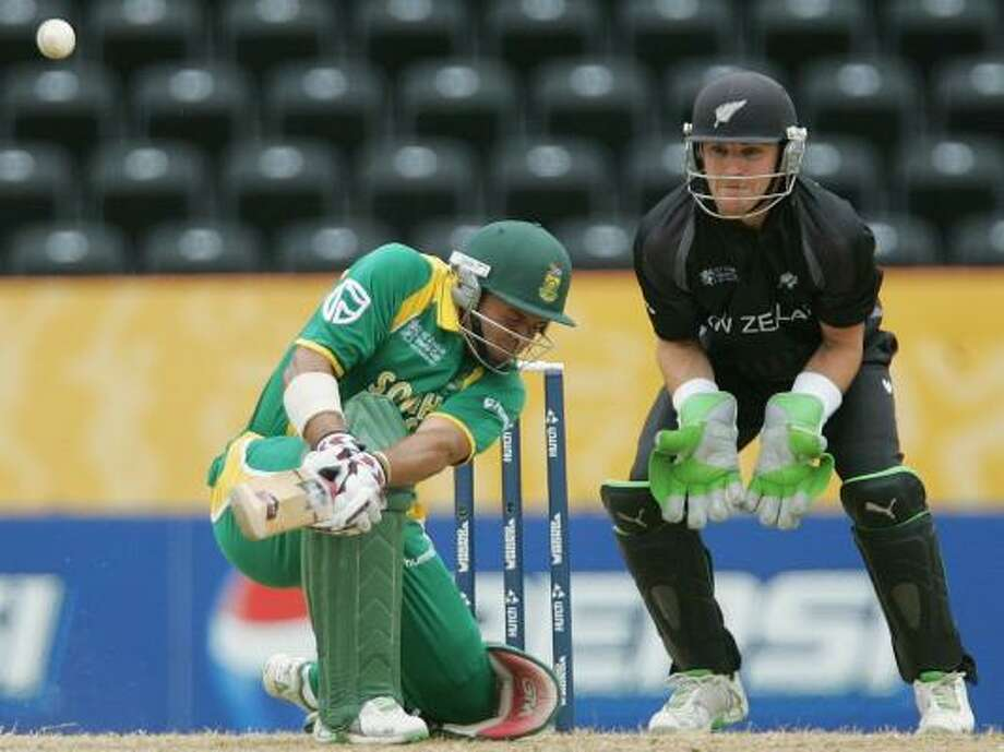 South Africa batsman Ashwell Prince, left, plays a shot as New Zealand wicketkeeper Brendon McCullum looks on during their Super Eight Cricket World Cup match in St. George's, Grenada, on Saturday. New Zealand won to advance to the semifinals. Photo: THEMBA HADEBE, ASSOCIATED PRESS