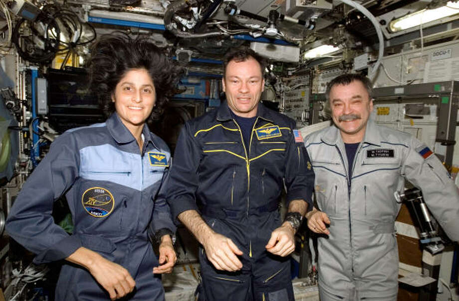 Flight engineer Sunita L. Williams, Commander Michael E. Lopez-Alegria and Russian flight engineer Mikhail Tyurin pose for a crew portrait on the international space station March 8. Photo: Nasa