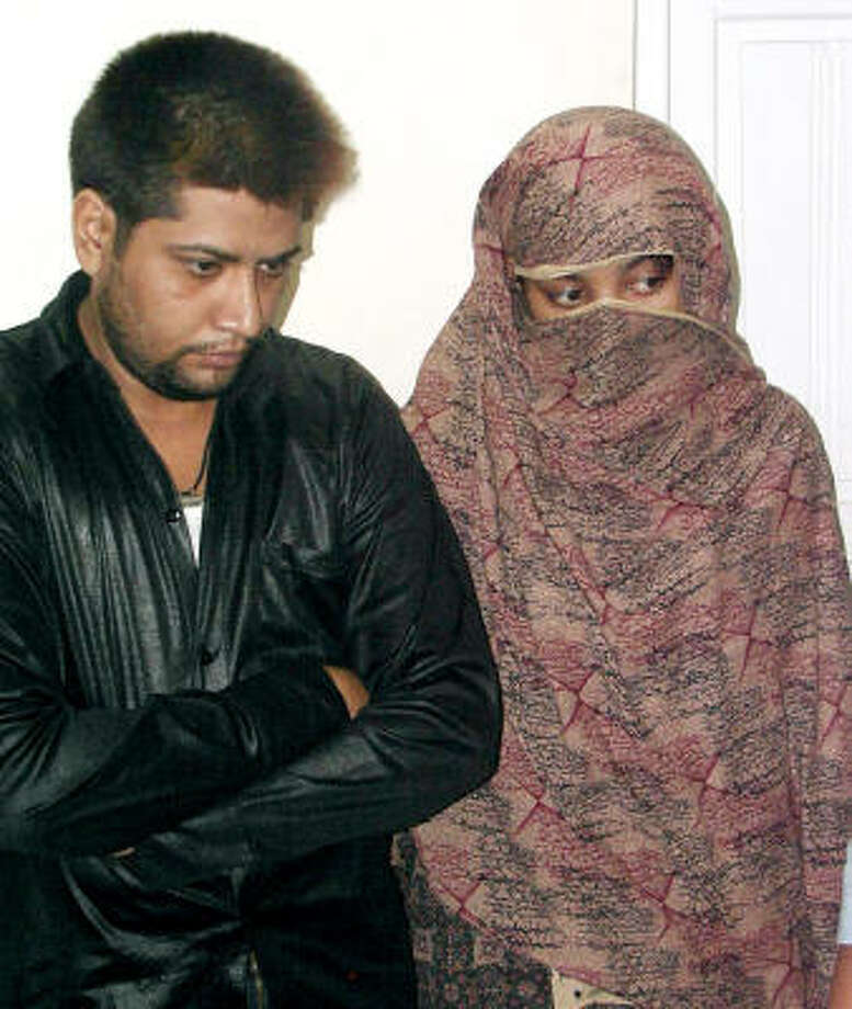 Shumail Raj, left,and Shahzina Tariq stand at a police station after their detention on Sunday in Faisalabad, Pakistan. Police arrested the couple in the eastern Pakistan on Sunday for allegedly making a false statement about the groom's gender who has been declared by doctors as a woman, despite a sex-change operation, an official said. Photo: KHALILUR REHMAN, AP