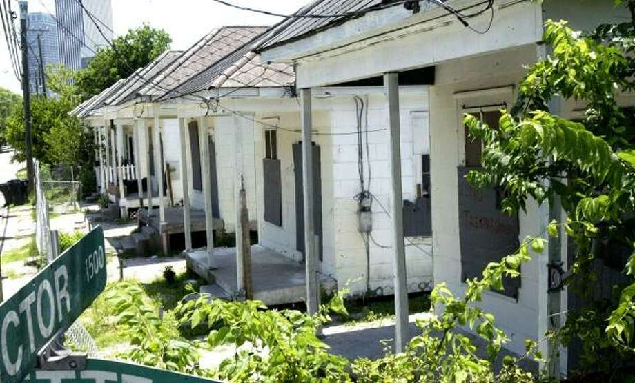 The 1930s shotgun-style houses on Victor Street are empty now that the last resident, 83-year-old Pearl Franklin, has moved out. Photo: JESSICA KOURKOUNIS, FOR THE CHRONICLE