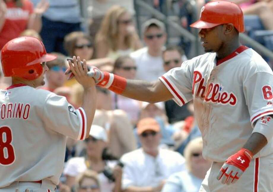With two homers, Ryan Howard, right, shows Shane Victorino and the rest of his teammates he's starting to heat up. Photo: GREGORY SMITH, ASSOCIATED PRESS
