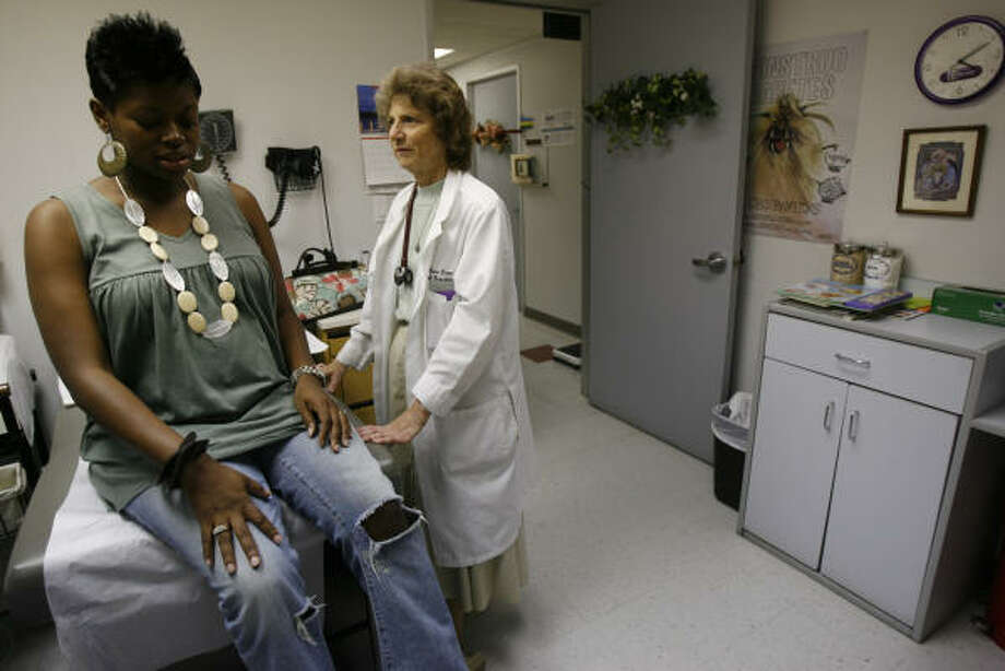 Sister Rosanne Popp, right, who is also a physician, talks with patient Tomira Moore at Christus Southwest Community Health Center. Sister Popp says using her skills as a doctor is the way she fulfills her vocation. Photo: Karen Warren, Chronicle