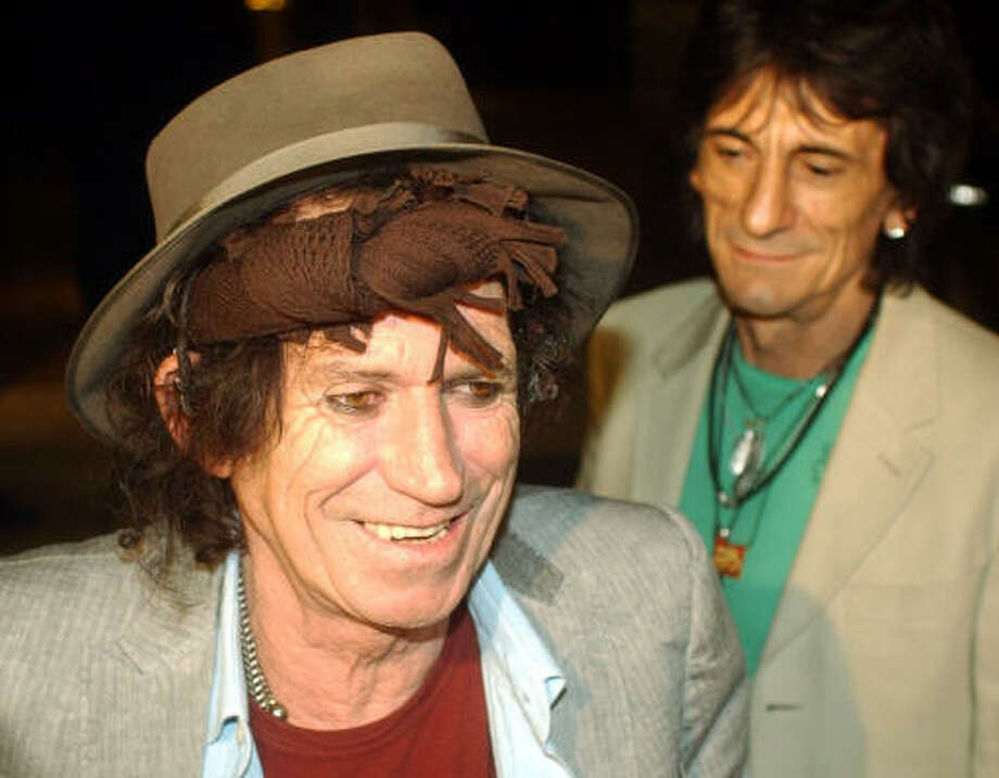 Keith Richards of the legendary The Rolling Stones rock group speaks to the press as band member Ron Wood, right,  looks on after their arrival with the band in Warsaw, Poland, on July 23. Photo: Alik Keplicz, AP
