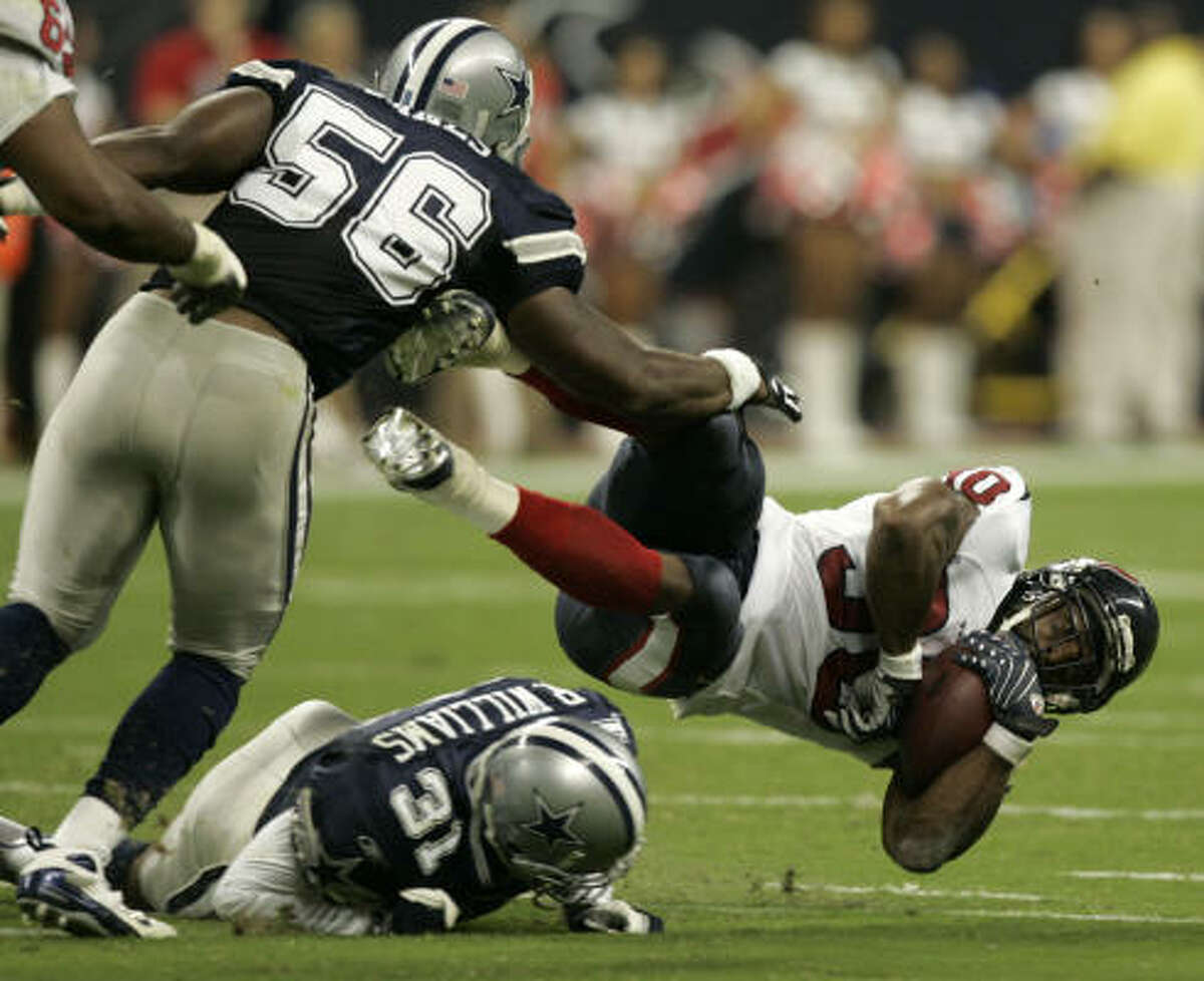The Texans have given Ahman Green a much nicer welcome than Dallas' Bradie James (56).