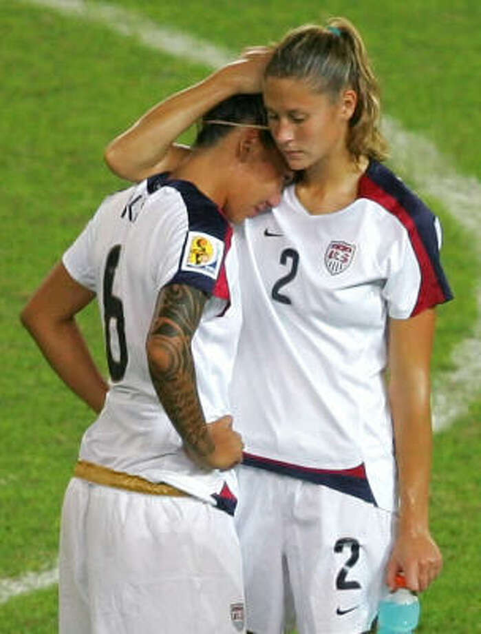 U.S. players Marian Dalmy, right, and Natasha Kai console each other after their shocking loss to Brazil in the semifinals of the Women's World Cup at Hangzhou, China, on Thursday. Photo: Greg Baker, AP