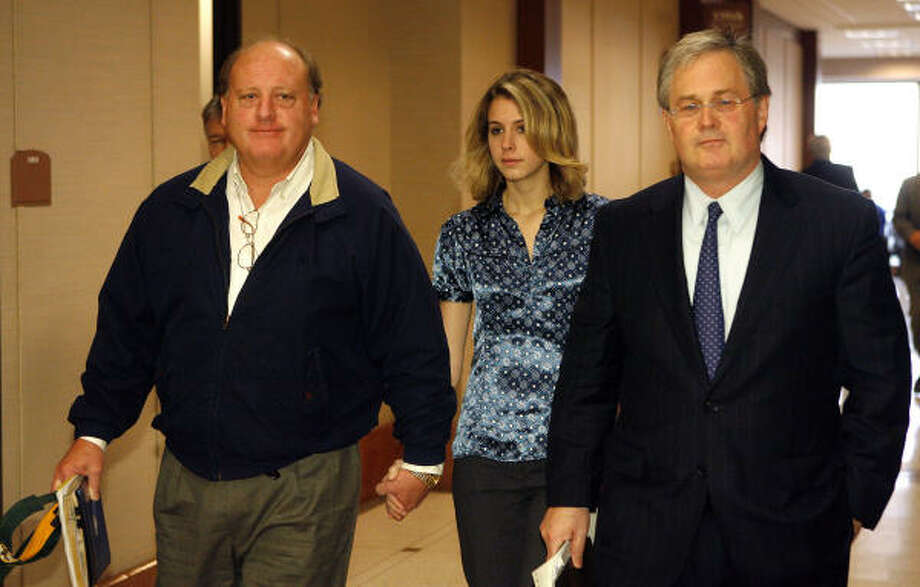At a hearing in May, Elizabeth Shelton walks out of a courtroom with her father, Judge Pat Shelton, left, and her attorney, Mac Secrest. Photo: Steve Campbell, Chronicle