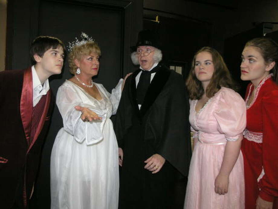 """Will Bryant, left, Julie Owne, Pevis Bell, Mignon Bryant and Kathleen Bryant practice for the Pasadena Little Theatre's """"A Christmas Carol."""" Photo:  Fannie Williams, For The Chronicle"""