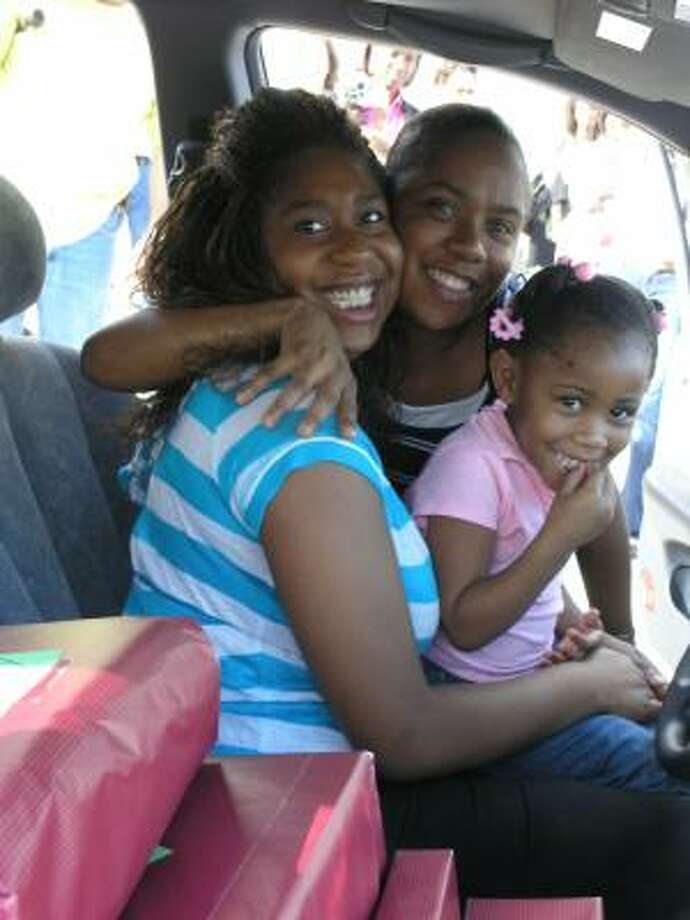 Recipient  Romeisha Simmons, her mother, B'Kette Simmons and her daughter, Tynia Williams, 4, are all smiles inside their new car. Photo:  Fannie Williams, For The Chronicle