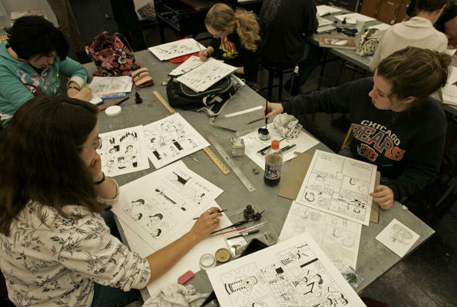 University of Cincinnati students, clockwise from bottom left, Cathy Walters, Emma Kaska, Earline Antosch and Mandy Mandell, work in a comics art class at the university in Cincinnati. Photo: Al Behrman, AP